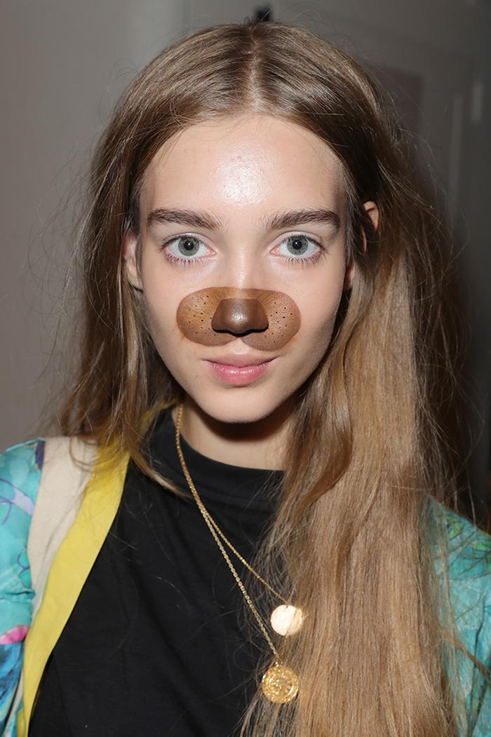 A Desigual model wears Snapchat filter makeup backstage before the NYFW show. (Photo: Getty)
