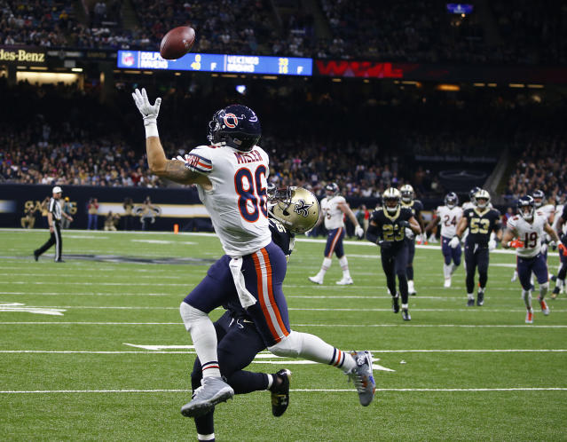 Chicago Bears tight end Zach Miller (86) pulls in a touchdown reception, that was ruled incomplete upon review, as New Orleans Saints defensive back Rafael Bush (25) covers, in the second half of an NFL football game in New Orleans, Sunday, Oct. 29, 2017. Miller injured his leg on the play and was carted off the field. (AP Photo/Butch Dill)