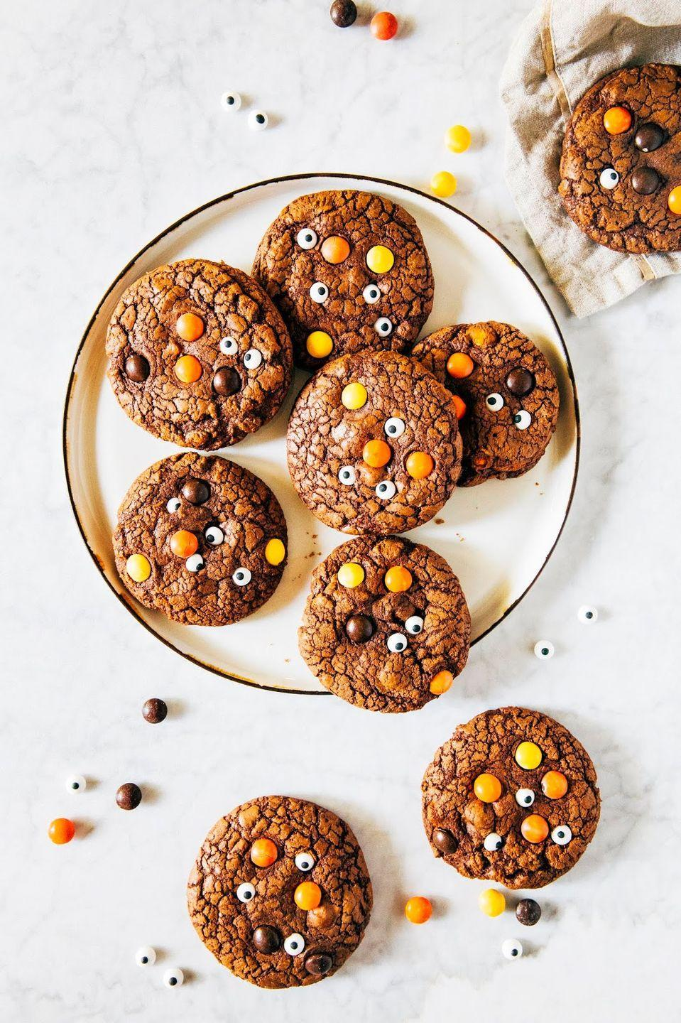 """<p>Few things hit the spot quite like """"brookies,"""" the cookie-brownie remix with just the right ratio of chewiness to crispiness. To make these guys monster-like, stick on a few candy eyes—but wait until <em>after</em> the baking process is complete to do so.</p><p><strong>Get the recipe at <a href=""""https://www.hummingbirdhigh.com/2018/10/monster-brookies.html"""" rel=""""nofollow noopener"""" target=""""_blank"""" data-ylk=""""slk:Hummingbird High"""" class=""""link rapid-noclick-resp"""">Hummingbird High</a>.</strong></p><p><a class=""""link rapid-noclick-resp"""" href=""""https://go.redirectingat.com?id=74968X1596630&url=https%3A%2F%2Fwww.walmart.com%2Fsearch%2F%3Fquery%3Dcookie%2Bsheets&sref=https%3A%2F%2Fwww.thepioneerwoman.com%2Ffood-cooking%2Fmeals-menus%2Fg32110899%2Fbest-halloween-desserts%2F"""" rel=""""nofollow noopener"""" target=""""_blank"""" data-ylk=""""slk:SHOP COOKIE SHEETS"""">SHOP COOKIE SHEETS</a></p>"""