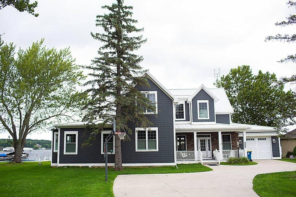 """<h2>Luxury Lakehouse on Snow Lake </h2><br><strong>Location:</strong> Fremont, Indiana<br><strong>Sleeps:</strong> 14<br><strong>Price Per Night:</strong> $425<br><em>Check availability <strong><a href=""""https://airbnb.pvxt.net/z5dvr"""" rel=""""nofollow noopener"""" target=""""_blank"""" data-ylk=""""slk:here"""" class=""""link rapid-noclick-resp"""">here</a></strong></em><br><br>""""Lovely home (3,300 square feet of living space) on Snow Lake. Perfect for your summer or winter family vacation. It will sleep 16 in beds and one crib. We have two and a half baths. It is beautifully decorated and furnished with everything you need for a fun getaway. Fully equipped upper-end kitchen and outdoor gas grill. We have games, puzzles, books, children's toys, sound system, internet, WIFI, TV, and DVDs for your indoor entertainment.""""<br><br>"""