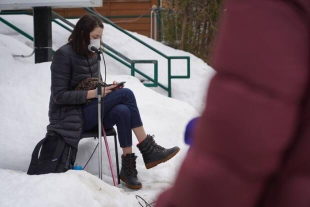Megan Linton, a disabilities justice advocate photographed here at a protest in February, says people living in these group settings should be fast-tracked higher up the COVID-19 vaccine queue. (Francis Ferland/CBC - image credit)