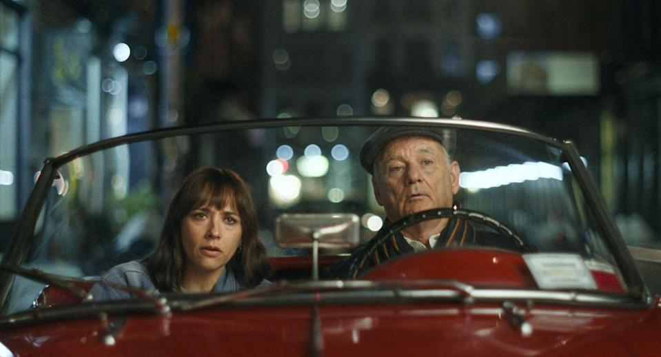 """<p>With <em>On the Rocks</em>, Sofia Coppola reunites with her <em>Lost in Translation </em>star Bill Murray for another odyssey involving a young woman and an older man. Though the results aren't as dynamic as their prior collaboration, Coppola's fizzy romantic drama nonetheless finds its headliner in outstanding form as Felix, the suave ladies-man father to Laura (Rashida Jones), with whom he embarks on an investigation into the possible two-timing proclivities of her husband Dean (Marlon Wayans). Seemingly riffing on Coppola's own famous dad Francis, Murray is a charming force of nature as an incorrigible lothario at once devoted to his mother-of-two kid and wholly, hilariously consumed with himself, and his performance does much to enliven this breezy saga about Laura's mid-life crisis. A nighttime race through Manhattan in an old-school sports car is the material's comedic high point, and contributes to the warmth and affection that Coppola showers upon her metropolitan setting, here envisioned as a dreamy wonderland full of intrigue, adventure and alternately enervating and enlivening domesticity.</p><p><a class=""""link rapid-noclick-resp"""" href=""""https://tv.apple.com/movie/umc.cmc.1mydlea6wicrm013138speg6m?itscg=MC_20000&itsct=atvp_brand_omd&mttn3pid=a_google_adwords&mttnagencyid=1625&mttncc=US&mttnsiteid=143238&mttnsubad=OUS2019868_1-474815196432-c&mttnsubkw=102354730290_kwd-22359895405_Pcuhpp9q_"""" rel=""""nofollow noopener"""" target=""""_blank"""" data-ylk=""""slk:Watch Now"""">Watch Now</a></p>"""
