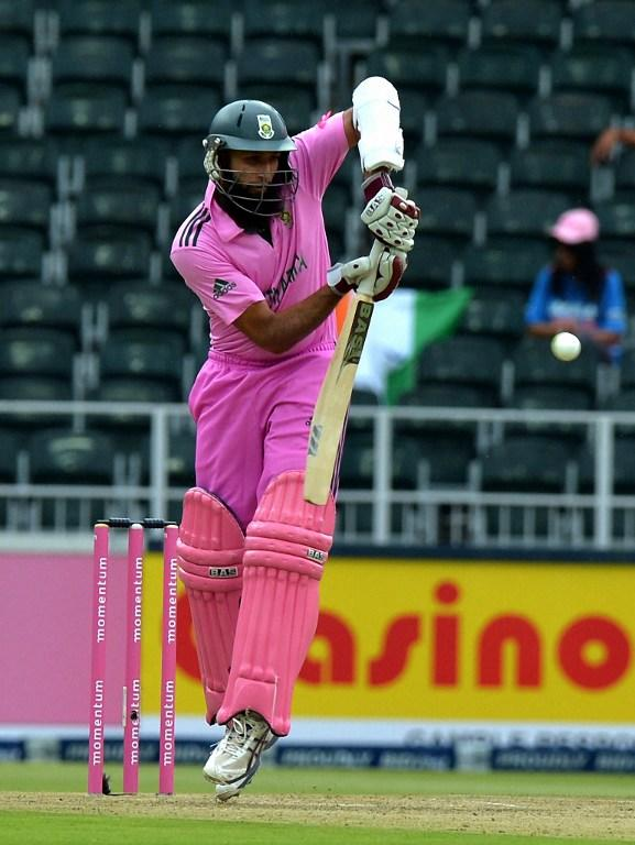 South Africa's batsman Hashim Amla plays a shot during the first one-day international betweeen South Africa and India at the Wanderers Stadium in Johannesburg on December 5, 2013.  AFP PHOTO / ALEXANDER JOE