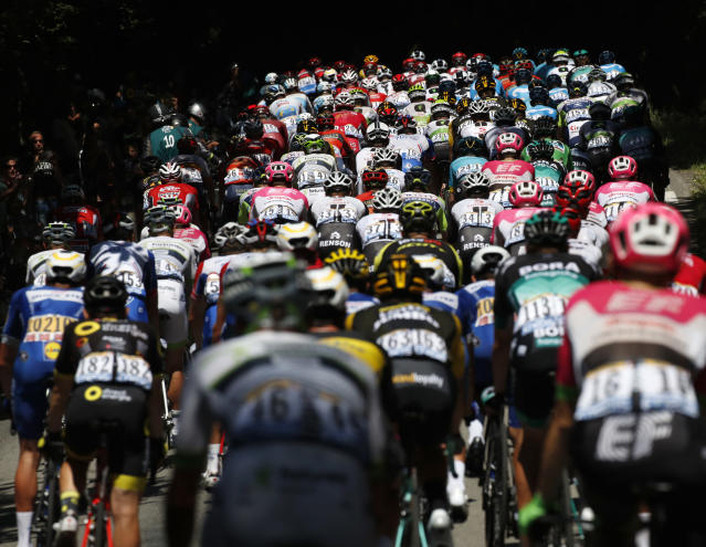 The pack climbs during the fifth stage of the Tour de France cycling race over 204.5 kilometers (127 miles) with start in Lorient and finish in Quimper, France, Wednesday, July 11, 2018. (AP Photo/Christophe Ena)