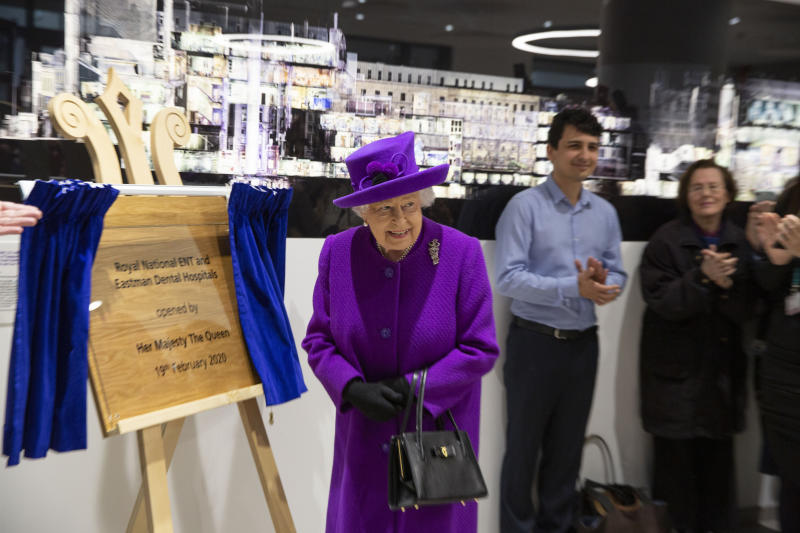 Queen Elizabeth II unveils a plaque during the official opening of the new premises of the Royal National ENT and Eastman Dental Hospitals in London.