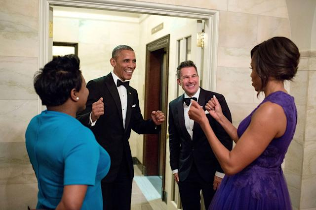 President Barack Obama and first ladyMichelle Obama celebrate with outgoing social secretary Jeremy Bernard and incoming social secretary Deesha Dyer in the Ground Floor Corridor following the State Dinner at the White House on April 28, 2015.