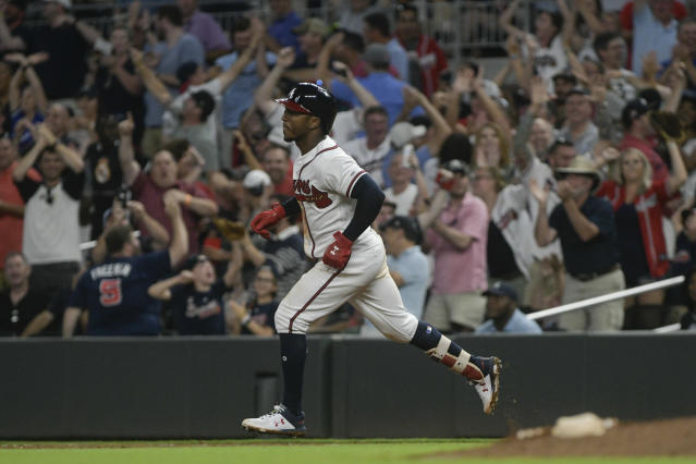 Atlanta Braves' Ozzie Albies runs the bases as fans cheer his grand slam during the sixth inning of a baseball game against the New York Mets, Tuesday, June 12, 2018, in Atlanta. (AP Photo/John Amis)