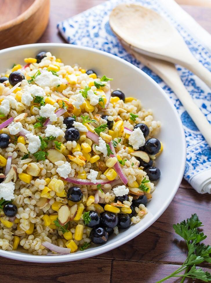 """<p>With a nod to one of summer's favorite ingredients, this grilled corn salad is even better than it looks. You can easily adjust the recipe to feed two people by sliding the slider down until it gets to the number """"2.""""</p> <p><strong>Get the recipe:</strong> <a href=""""http://sweetpeasandsaffron.com/2015/06/grilled-corn-and-barley-salad-with-blueberries-and-goat-cheese.html"""" class=""""link rapid-noclick-resp"""" rel=""""nofollow noopener"""" target=""""_blank"""" data-ylk=""""slk:grilled corn and barley salad with blueberries and goat cheese"""">grilled corn and barley salad with blueberries and goat cheese</a> </p>"""