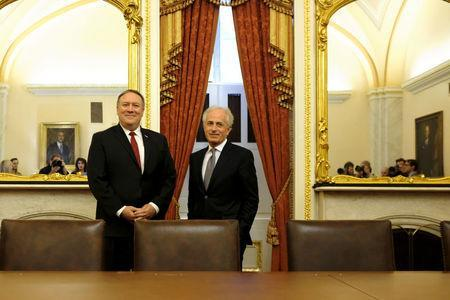 U.S. Senate Foreign Relations Committee Chairman Bob Corker (R-TN), R, meets with CIA Director Mike Pompeo, L, President Trump's nominee for Secretary of State, at the U.S. Capitol in Washington March 19, 2018. REUTERS/James Lawler Duggan