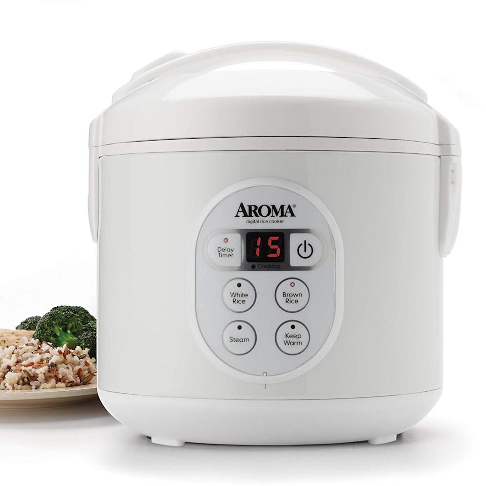 "<p>""After a long day of work, the last thing I want to do is cook a meal. Although whipping up a healthy dinner may not be my specialty, it doesn't mean I don't need to cook. To make my life easier, I recently bought this <span>Aroma Housewares 8-Cup Digital Rice Cooker</span> ($33, originally $40), and now I can't imagine living without it.</p> <p>Originally, I was just looking for a rice cooker, but when I saw this was also a food steamer, I was instantly sold. I can cook my favorite brown or wild rice in several different serving sizes (depending on the amount of people) because it can prepare anywhere from two to eight cups. Simultaneously, it can also make a batch of freshly steamed vegetables. To add some protein, I can even add meat or fish to complete my dish.</p> <p>The easy-to-use device comes with a digital program display and it has a 15-hour delay timer so you can prep your meal before work and come home to it ready. It includes a BPA-free steam tray, measuring cup, and serving spatula, all of which are dish-washer safe - making clean up just as simple. So if you're looking to save time on meal prepping or family dinners, give this cooker a try!"" - KJ</p>"