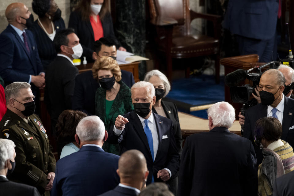 WASHINGTON, DC - APRIL 28:   President Joe Biden speaks with lawmakers as he exits the House chamber at the end of his address to the joint session of Congress in the House chamber of the U.S. Capitol April 28, 2021 in Washington, DC. On the eve of his 100th day in office, Biden will speak about his plan to revive America's economy and health as it continues to recover from a devastating pandemic. He will deliver his speech before 200 invited lawmakers and other government officials instead of the normal 1600 guests because of the ongoing COVID-19 pandemic. (Photo by Caroline Brehman - Pool/Getty Images)