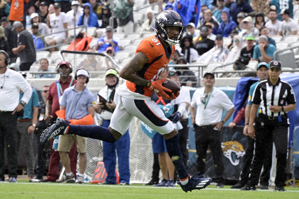 Denver Broncos wide receiver Tim Patrick (81) scores a touchdown on a 12-yard pass play against the Jacksonville Jaguars during the first half of an NFL football game, Sunday, Sept. 19, 2021, in Jacksonville, Fla. (AP Photo/Phelan M. Ebenhack)