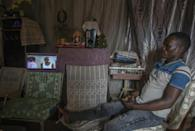Screen time: There's even enough power left over to drive a small television (AFP/AMOS GUMULIRA)