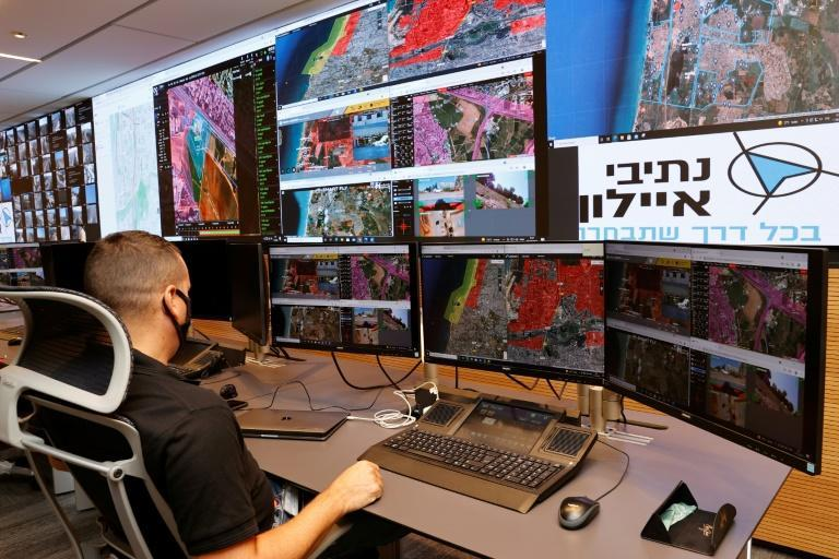 An air traffic controller monitors screens at the Drone Air Control Centre in the Israeli coastal city of Tel Aviv (AFP/JACK GUEZ)