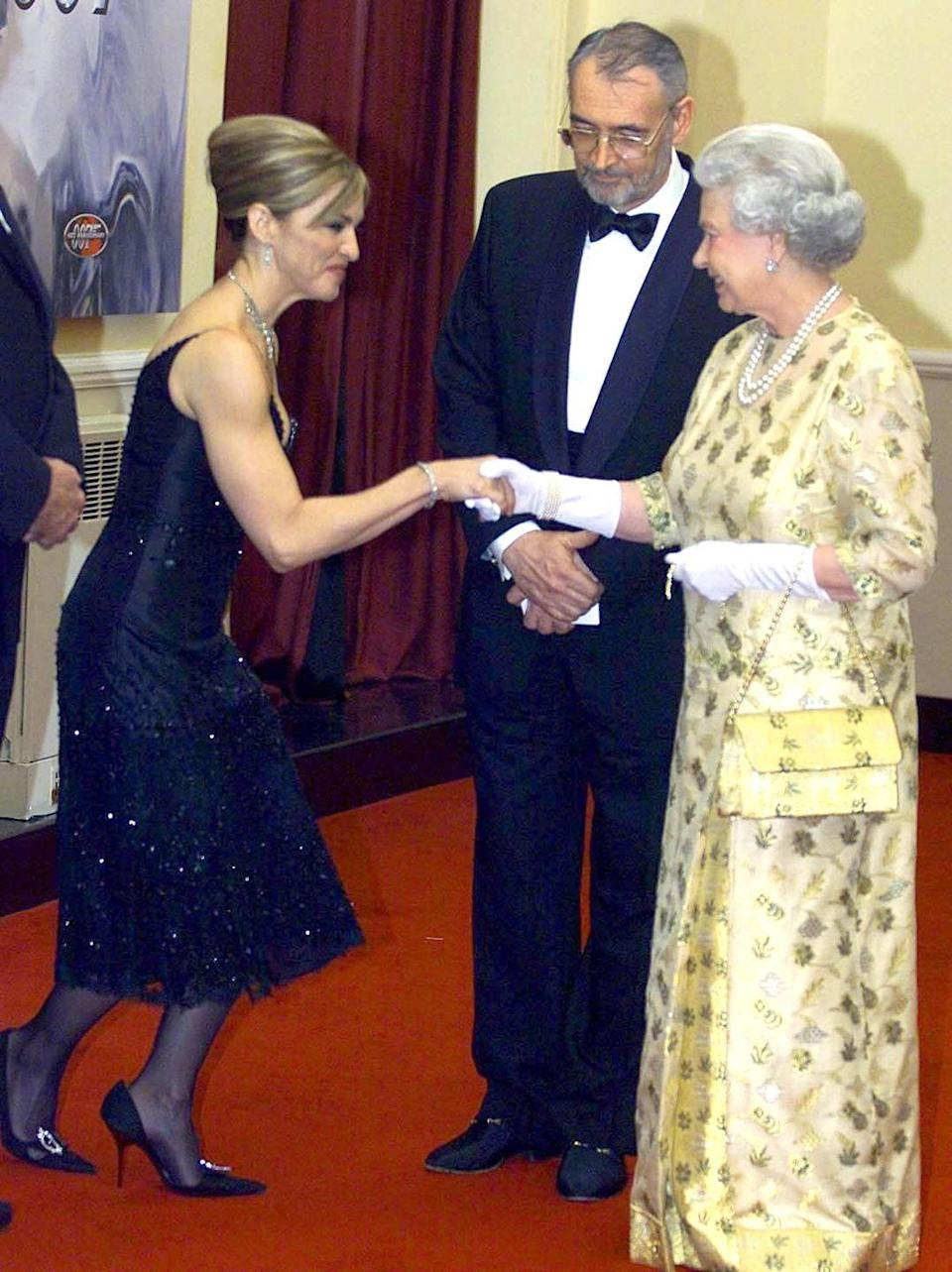 <p>This is what it looks like when the Queen of Pop meets the Queen of England. This was for the premiere of <em>Die Another Day</em>. Also, please note Madonna's killer arms.</p>