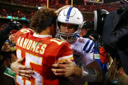 Jan 12, 2019; Kansas City, MO, USA; Kansas City Chiefs quarterback Patrick Mahomes (15) and Indianapolis Colts quarterback Andrew Luck (12) shake hands after the AFC Divisional playoff football game at Arrowhead Stadium. Mandatory Credit: Mark J. Rebilas-USA TODAY Sports