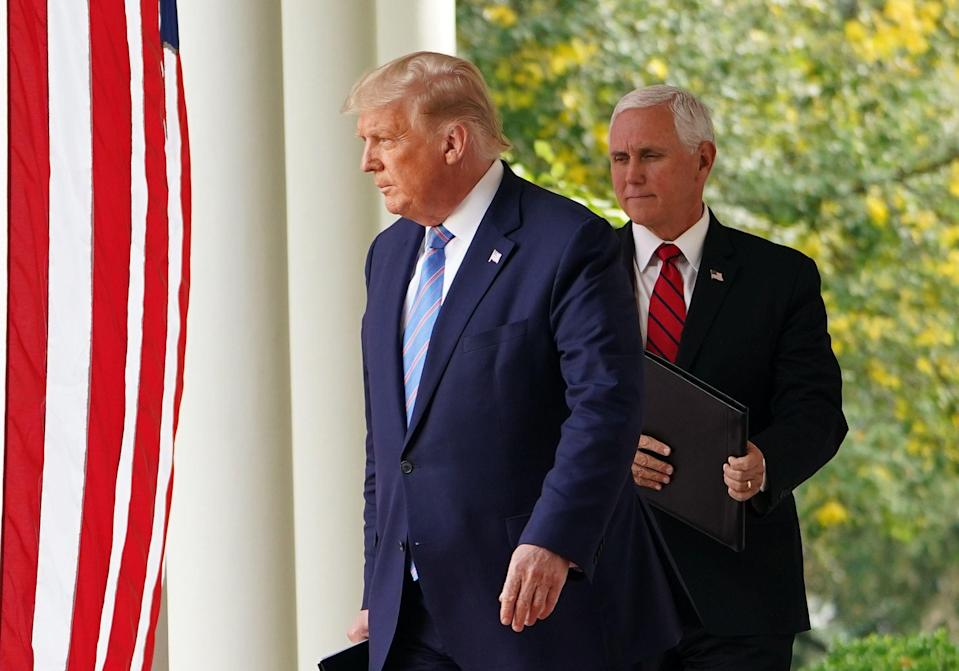 Trump and Pence arrive to speak on Covid-19 testing in the Rose Garden (AFP via Getty Images)