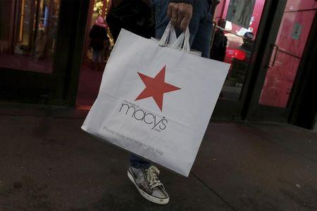 A customer exits the Macy's flagship department store in midtown Manhattan in New York City