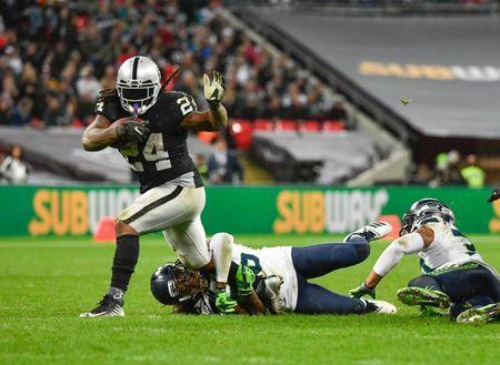 FILE PHOTO: Oct 14, 2018; London, United Kingdom; Oakland Raiders running back Marshawn Lynch (24) is tackled during the third quarter of the game against the Seattle Seahawks during an International Series game at Wembley Stadium. Mandatory Credit: Steve Flynn-USA TODAY Sports