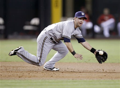 CORRECTS TO SUNDAY, MAY 27, 2012, NOT SATURDAY, MAY 26, 2012 - Milwaukee Brewers third baseman Taylor Green fields a ground ball hit for an out by Arizona Diamondbacks' Justin Upton in the first inning of a baseball game on Sunday, May 27, 2012, in Phoenix. (AP Photo/Paul Connors)