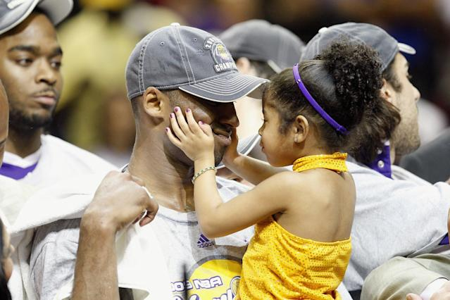 Kobe Bryant #24 of the Los Angeles Lakers holds his daughter, Gianna, after the Lakers defeated the Orlando Magic in Game Five of the 2009 NBA Finals on June 14, 2009 at Amway Arena in Orlando, Florida. The Lakers won 99-86. (Photo by Ronald Martinez/Getty Images)