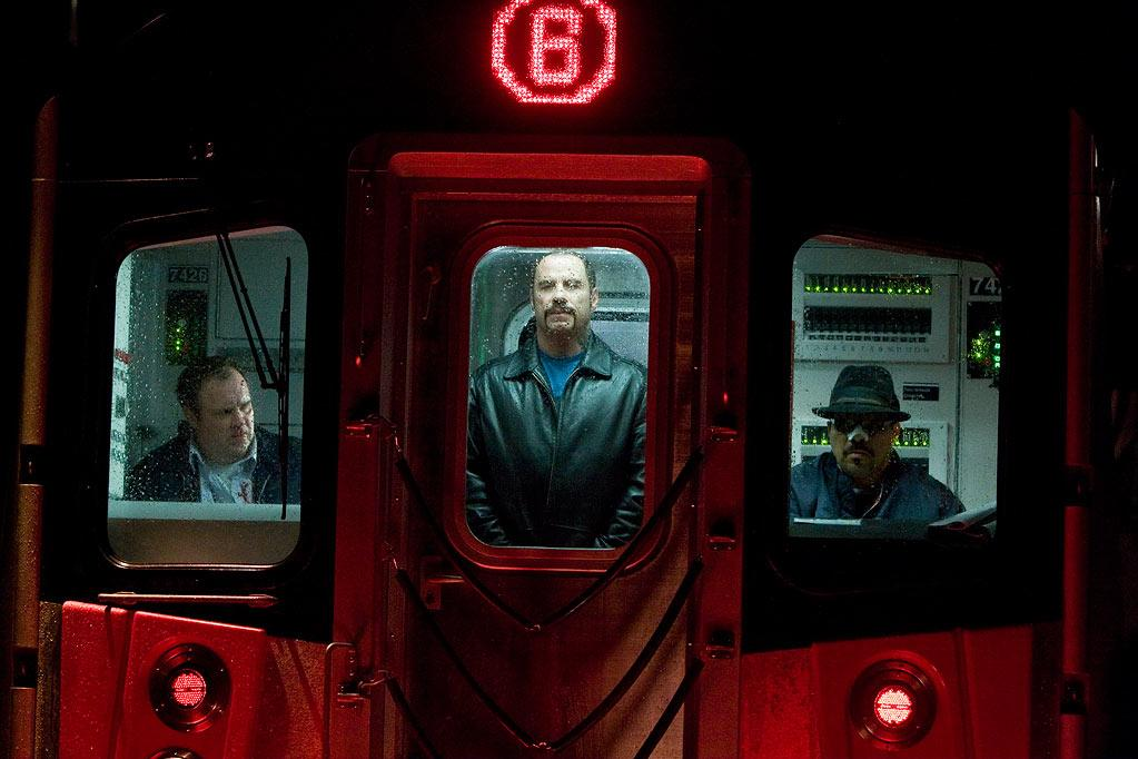 """Movie: <a href=""""http://movies.yahoo.com/movie/1810003158/info"""">The Taking of Pelham 1 2 3</a>  Catastrophe: John Travolta with a silly haircut holds a subway car hostage.   Outcome: Denzel Washington saves the train, shoots the bad guy, and buys some milk."""