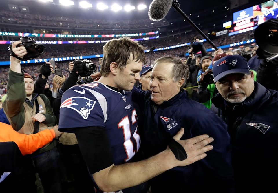In this Jan. 21, 2018, file photo, New England Patriots quarterback Tom Brady, left, hugs coach Bill Belichick after the AFC championship NFL football game against the Jacksonville Jaguars, in Foxborough, Mass. Brady is an NFL free agent for the first time in his career.