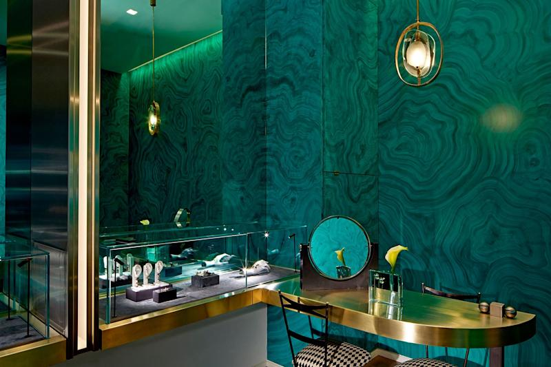 Delfina Delettrez's Mayfair, London boutique, with walls lined with mirror and painted with a trompe l'oeil malachite pattern.