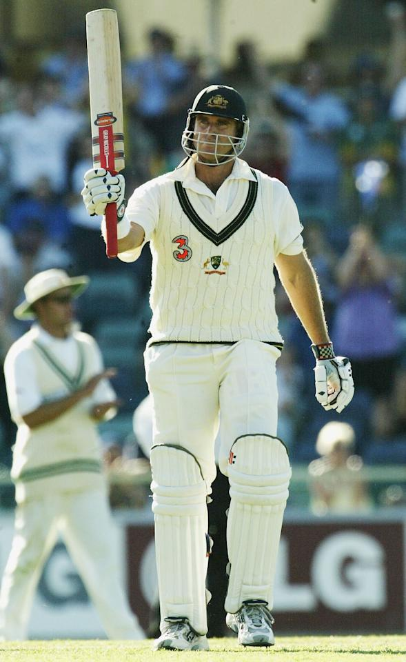 PERTH, AUSTRALIA - OCTOBER 9:  Matthew Hayden of Australia reaches 100 during day one of the First Test between Australia and Zimbabwe played at the WACA on October 9, 2003 in Perth, Australia. (Photo by Hamish Blair/Getty Images)
