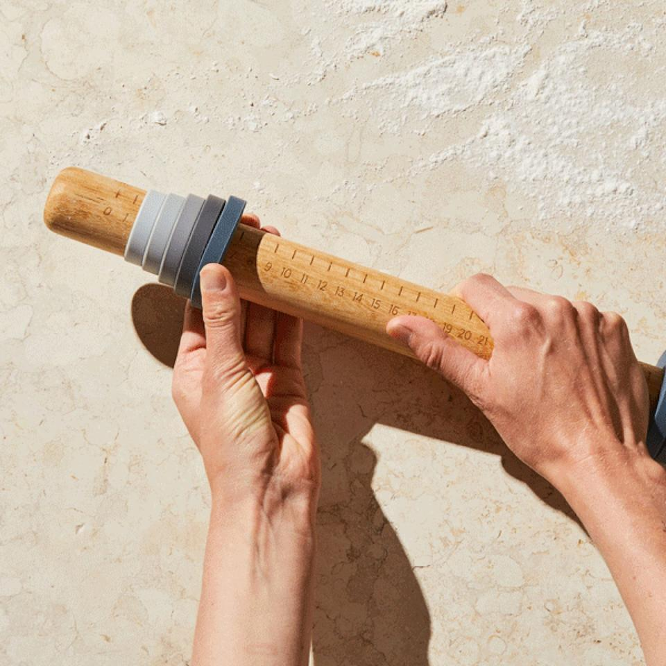 """This rolling pin isn't like the others. It can be adjusted to five different sizes andbuilt-in measurement markers. Not only will your baked goods taste good, they'll be accurate AF.<a href=""""https://fave.co/3dKmEYA"""" target=""""_blank"""" rel=""""noopener noreferrer"""">Find it for $39 at Food52</a>."""