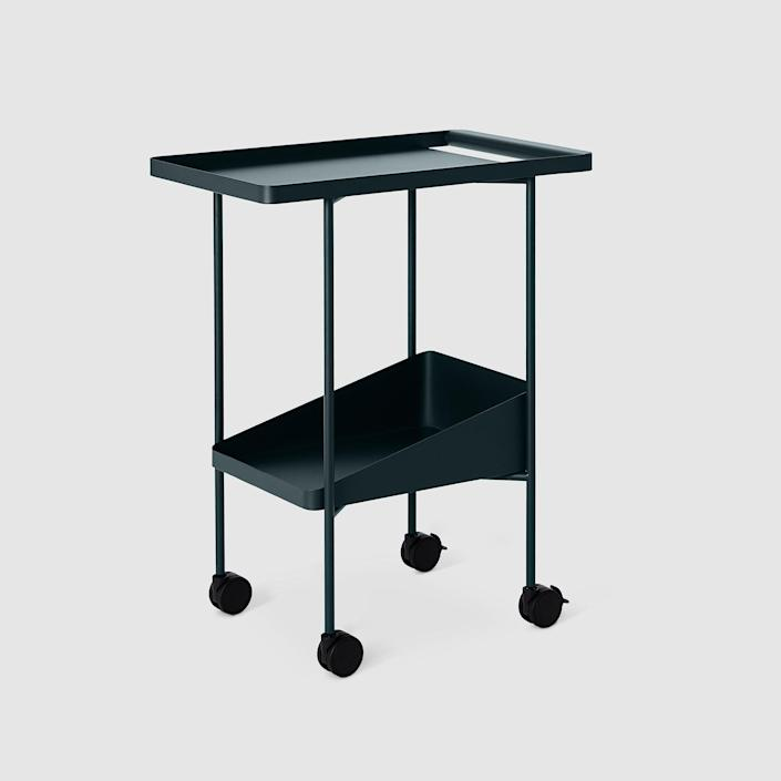 """I love the solid, simple """"architectural riff"""" of this bar cart. The utility and design make it worth wheeling around anywhere in your home. $425, Dims. <a href=""""https://www.dims.world/products/barbican-trolley?variant=17237042135138&utm_campaign=gs-2021-04-01&utm_source=google&utm_medium=smart_campaign&gclid=CjwKCAjwuvmHBhAxEiwAWAYj-LFEoWuKc8Liq-XtenVzbfhR8wcYzJPvCAf5t6_FlRux7n6jHmfn3xoCO1MQAvD_BwE"""" rel=""""nofollow noopener"""" target=""""_blank"""" data-ylk=""""slk:Get it now!"""" class=""""link rapid-noclick-resp"""">Get it now!</a>"""