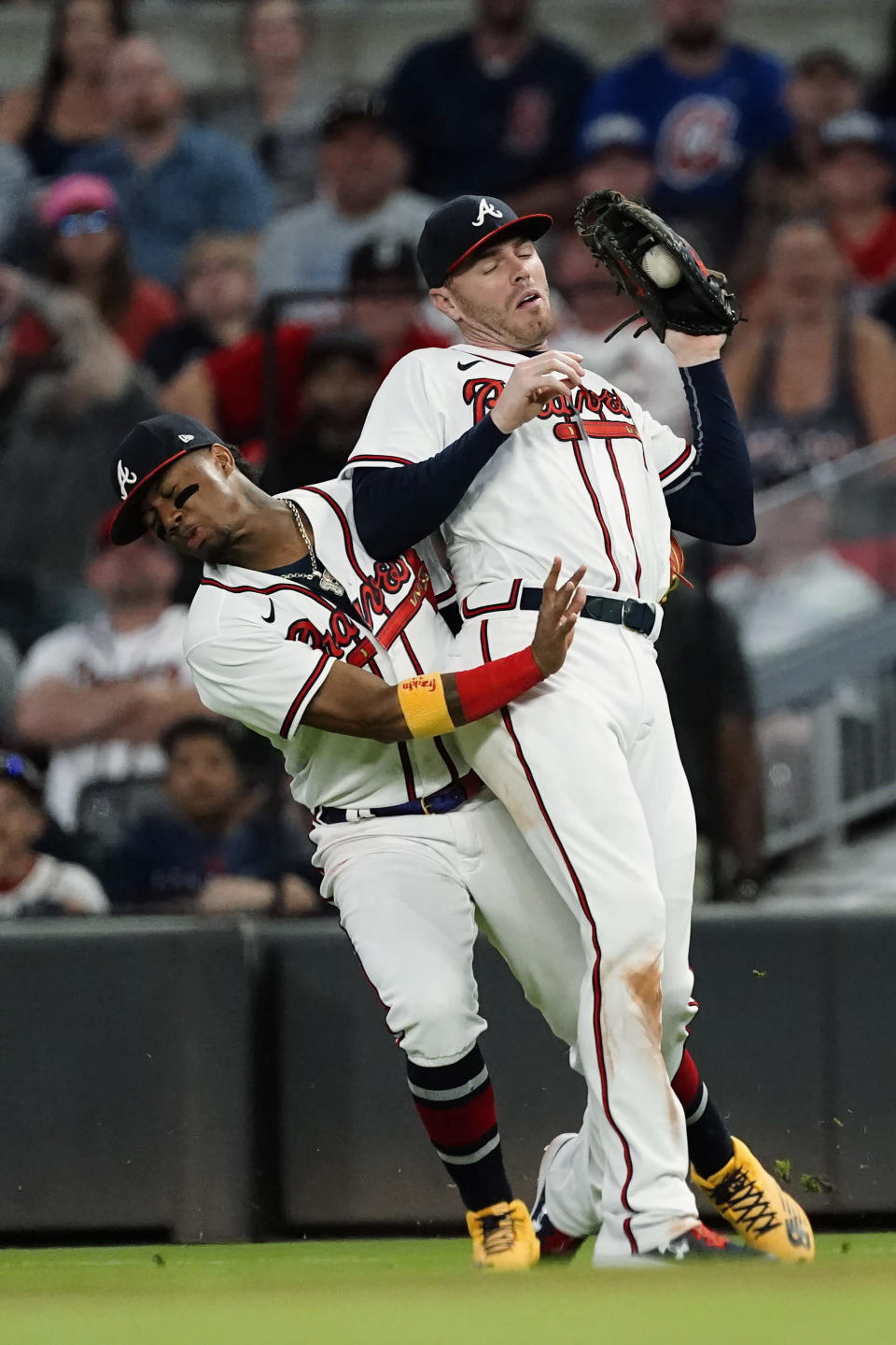 Atlanta Braves first baseman Freddie Freeman, right, collides with right fielder Ronald Acuna Jr. as he catches a fly ball from Boston Red Sox's Hunter Renfroe during the seventh inning of a baseball game Wednesday, June 16, 2021, in Atlanta. (AP Photo/John Bazemore)