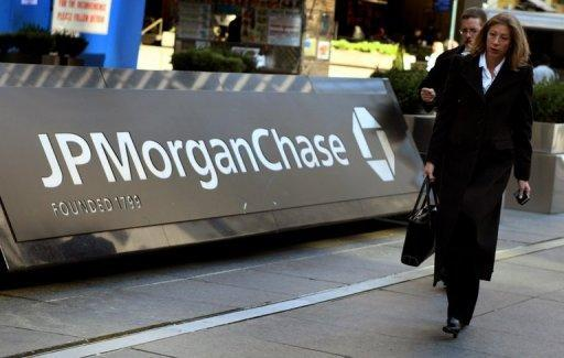 Pedestrians walk past the JP Morgan Chase headquarters in New York in 2008. The company has been fined $88.3 million for breaking US sanctions against regimes in Iran, Cuba and Sudan, and the former regime in Liberia, the US Treasury Department announced