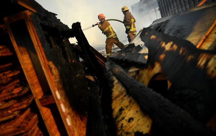 COMPTON, CALIFORNIA FEBRUARY 26, 2021-Firefighters battle an industrial fire in Compton Friday morning. Multiple structers, vehicles and wooden pallets were burned. (Wally Skalij/Los Angeles Times)