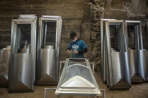 """""""Before the pandemic we made 100 coffins a month, now we make that many in a week!"""" says coffin-maker Genaro Cabrera"""