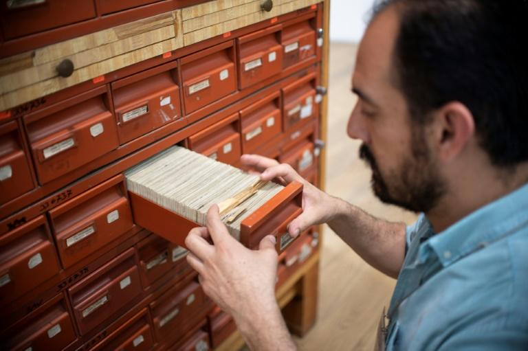 A historian works at the General Archive of the Nation, in Mexico City, on March 13, 2019, after the recent declassification of the archives of the Mexican intelligence service