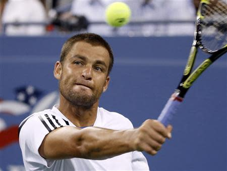 Mikhail Youzhny of Russia returns a backhand to Novak Djokovic of Serbia during their quarter-final match at the U.S. Open tennis championships in New York September 5, 2013. REUTERS/Mike Segar