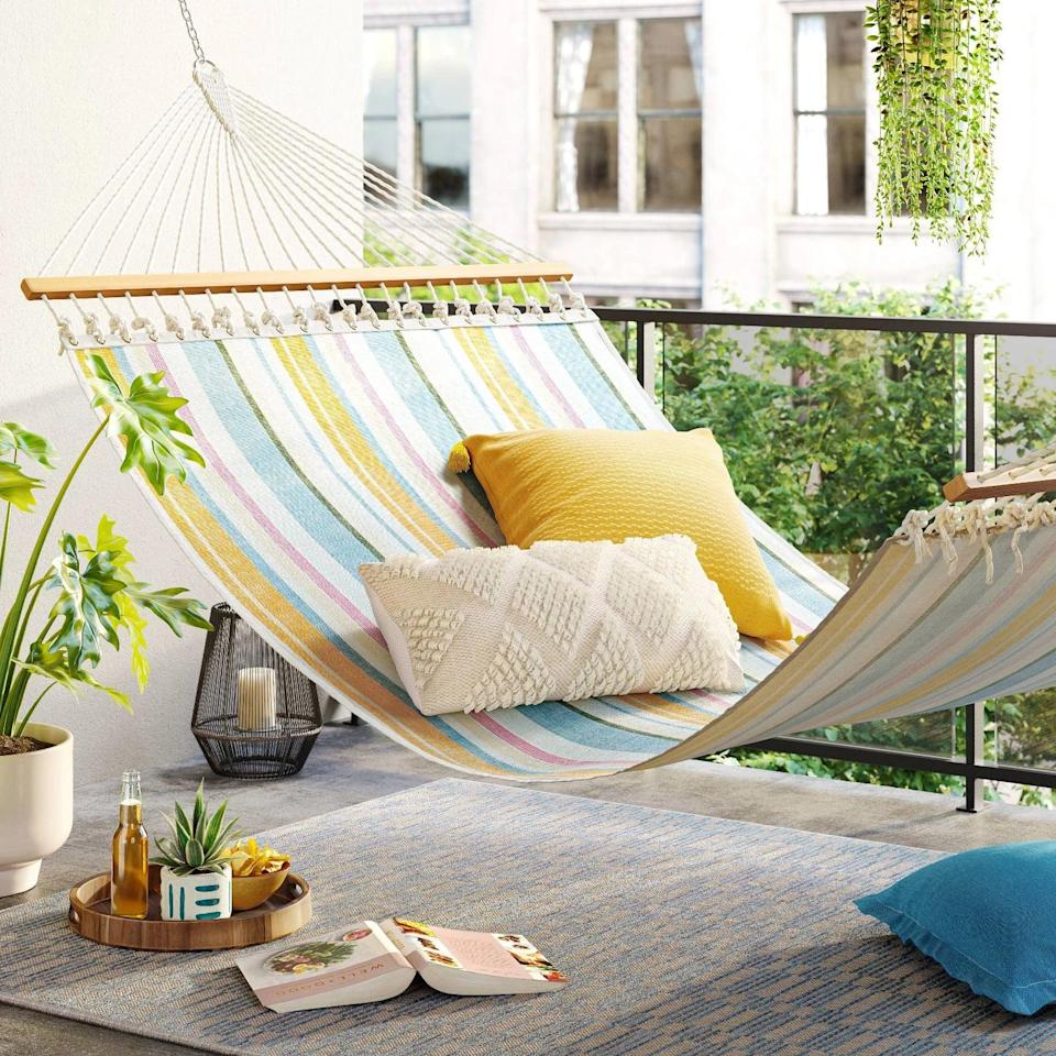 <p>Lounge in the relaxing warm weather and read a good book on this <span>Threshold Flat Weave Hammock</span> ($80). It adds a playful yet vibrant touch to your decor and it's functional!</p>
