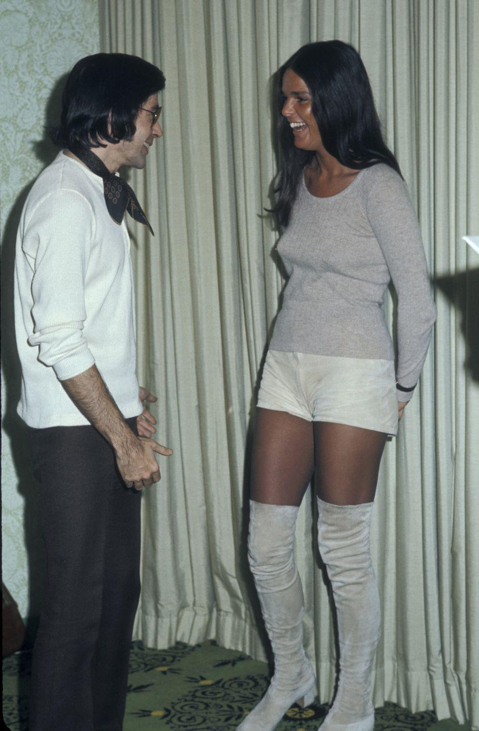 <p>In the '70s, other boot styles, like these suede knee-highs worn by Ali McGraw, were also all the rage.</p>