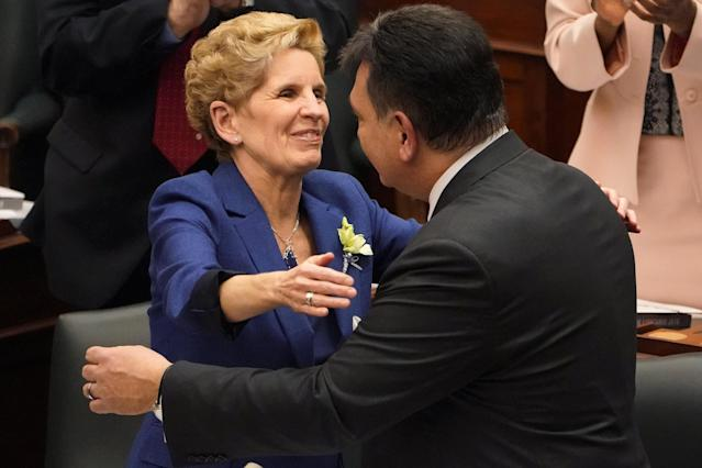 Ontario Premier Kathleen Wynne hugs Finance Minister Charles Sousa following the budget unveiling at Queen's Park in Toronto, Ontario, Canada, March 28, 2018. REUTERS/Carlo Allegri