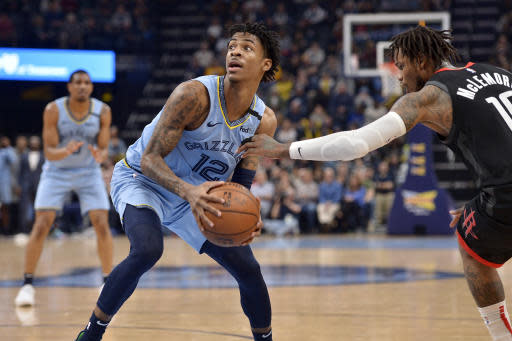 Memphis Grizzlies guard Ja Morant (12) is defended by Houston Rockets guard Ben McLemore (16) in the second half of an NBA basketball game Tuesday, Jan. 14, 2020, in Memphis, Tenn. (AP Photo/Brandon Dill)