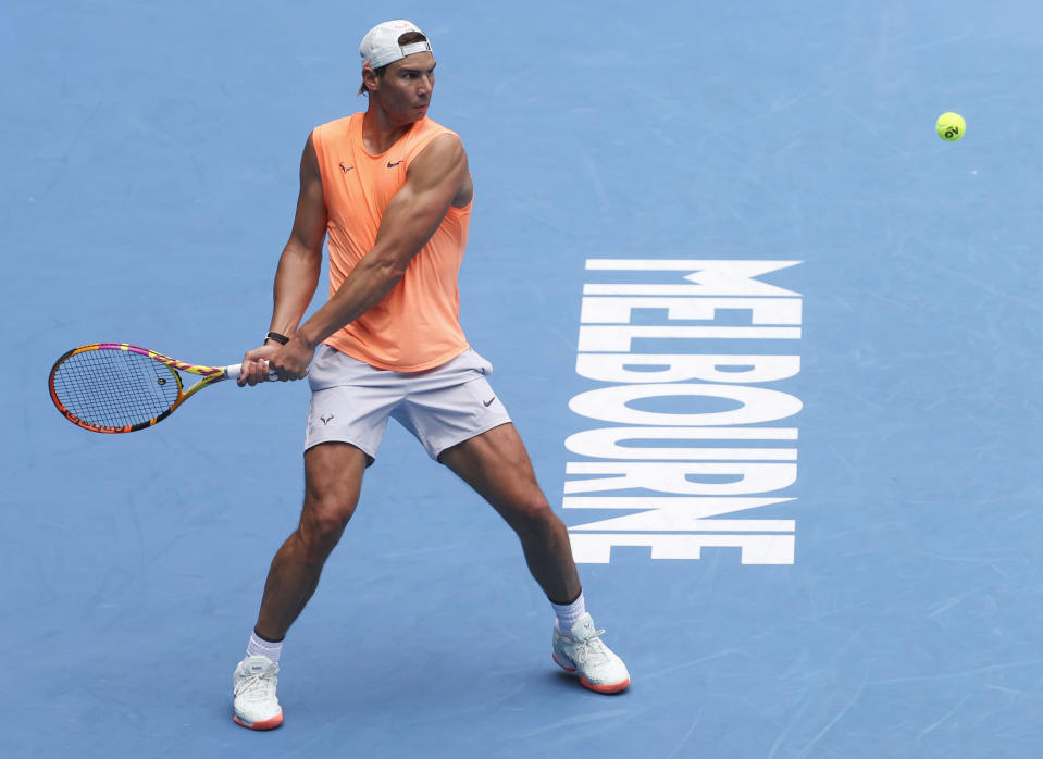 Spain's Rafael Nadal hits a backhand during a practice session ahead of the Australian Open in Melbourne, Australia, Sunday, Feb. 7, 2021.(AP Photo/Hamish Blair)