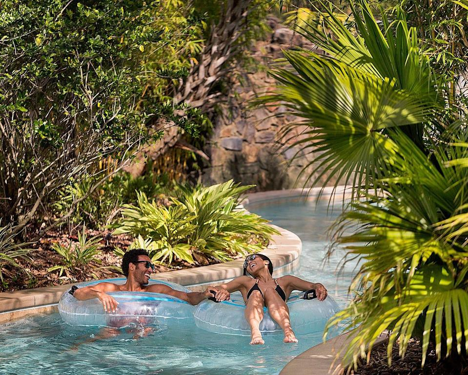 The Explorer Island water park at Four Seasons Resort Orlando is set among tropical foliage and cascading waterfalls for the ultimate in relaxation.