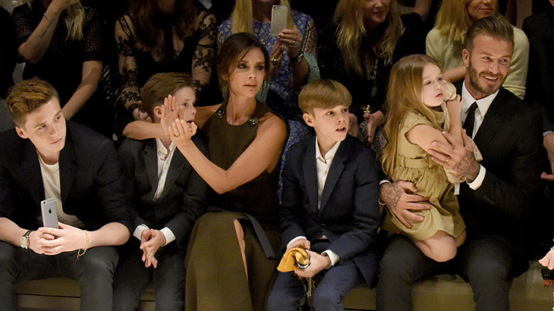 The Beckham family at a Burberry fashion show. Photo: Getty Images