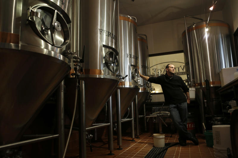 In this Monday, Oct. 8, 2012 photo, Anthony Cavallo, owner of the restaurant Vintage 50, poses for a portrait in the microbrewery of his restaurant in Leesburg, Va. As a small businessman, he wonders when the economic uncertainty will fade and people will start spending. (AP Photo/Jacquelyn Martin)