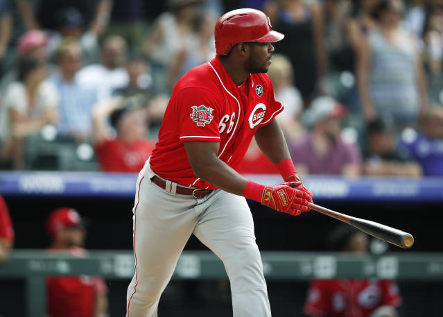 Cincinnati Reds' Yasiel Puig lines out against Colorado Rockies relief pitcher Wade Davis to end the ninth inning of a baseball game Sunday, July 14, 2019, in Denver. The Rockies won 10-9. (AP Photo/David Zalubowski)
