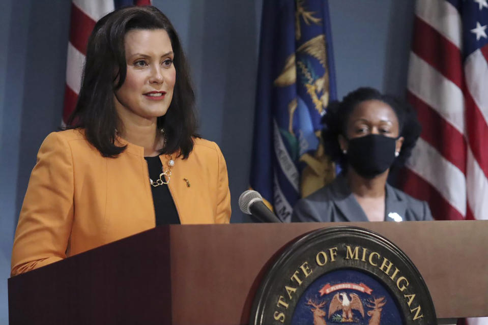 FILE - In this Aug. 19, 2020, file photo, provided by the Michigan Office of the Governor, Michigan Gov. Gretchen Whitmer addresses the state during a speech in Lansing, Mich. On Wednesday, Aug. 26, 2020, the Justice Department sent letters to the governors of Michigan and three other Democratic-led states, seeking data on whether they violated federal law by ordering public nursing homes to accept recovering COVID-19 patients from hospitals, actions that have been criticized for potentially fueling the spread of the virus (Michigan Office of the Governor via AP, File)