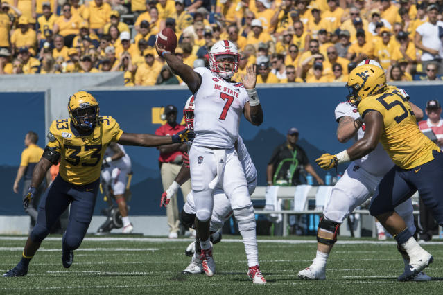 North Carolina State quarterback Matthew McKay (7) attempts a pass during the second half of an NCAA college football game against West Virginia Saturday, Sept. 14, 2019, in Morgantown, W.Va. (AP Photo/Raymond Thompson)
