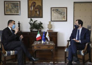 Cypriot Foreign Minister Nicos Christodoulides, right, and Italian Foreign Minister Luigi Di Maio talk during their meeting at the Foreign Ministry house in Nicosia, Cyprus, Tuesday March 9, 2021. Maio is in Cyprus for one-day visit. (Yiannis Kourtoglo/Pool via AP)