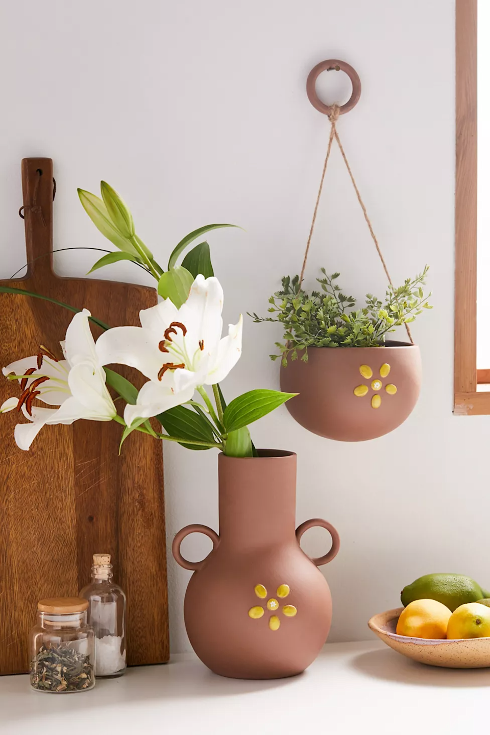"""<h2>Urban Outfitters Malia Hanging Planter</h2><br>One way to cheer up your WFH space? Re-pot your favorite green friend inside a happy daisy hanging planter.<br><br><strong>Urban Outfitters</strong> Malia Hanging Planter, $, available at <a href=""""https://go.skimresources.com/?id=30283X879131&url=https%3A%2F%2Fwww.urbanoutfitters.com%2Fshop%2Fmalia-hanging-planter"""" rel=""""nofollow noopener"""" target=""""_blank"""" data-ylk=""""slk:Urban Outfitters"""" class=""""link rapid-noclick-resp"""">Urban Outfitters</a>"""
